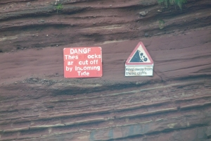 Safety signs point out dangerous cliff faces (also look out for cliffs covered by plants)
