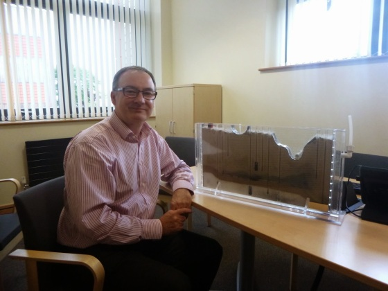 Dr Rob Ward with the amazing sand tank model he and his team use in outreach events!
