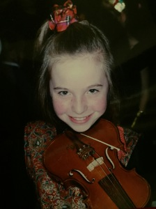 My short lived career as a violinist - note the snazzy waistcoat and scrunchie!