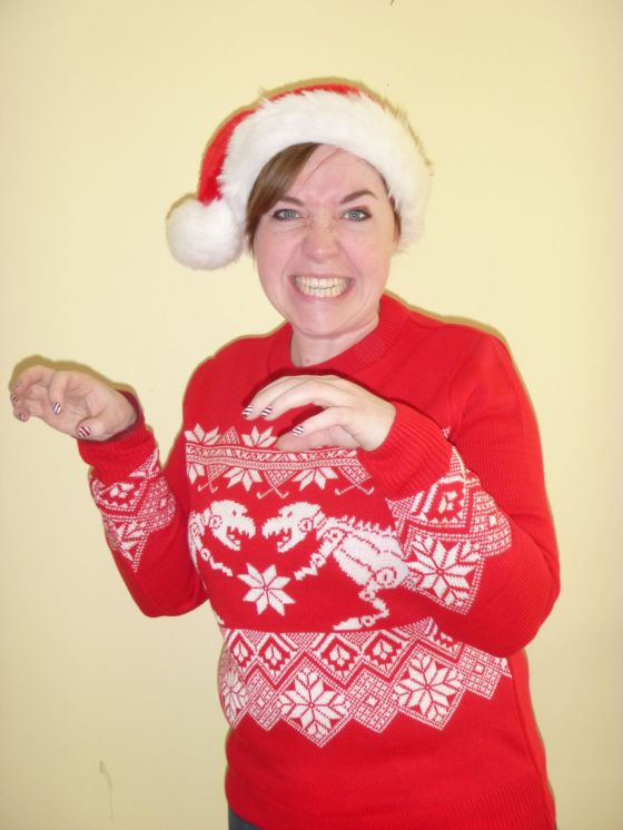 It's a DINOSAUR CHRISTMAS JUMPER!